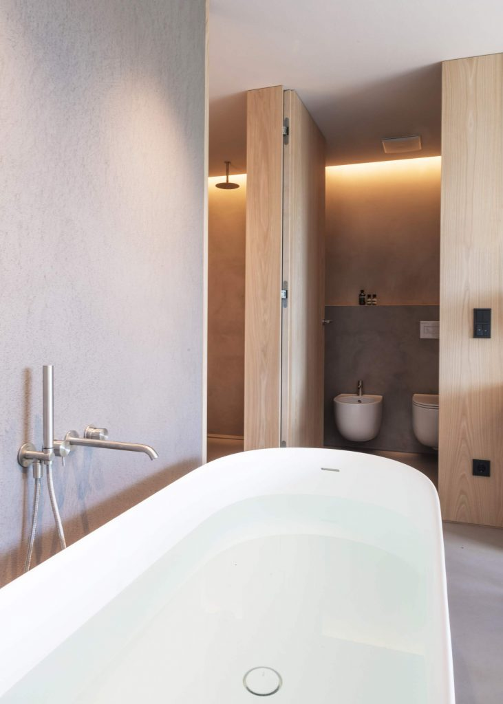 The Freestanding Bath and Master Bathroom of the Family Suite at Hotel Schgaguler in Castelrotto